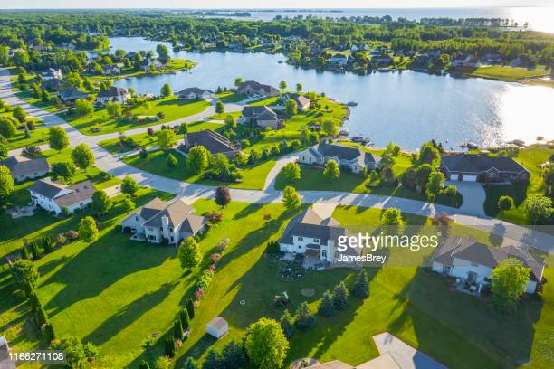 beautiful waterfront homes on lake at sunrise in summertime. - waterfront stock pictures, royalty-free photos & images