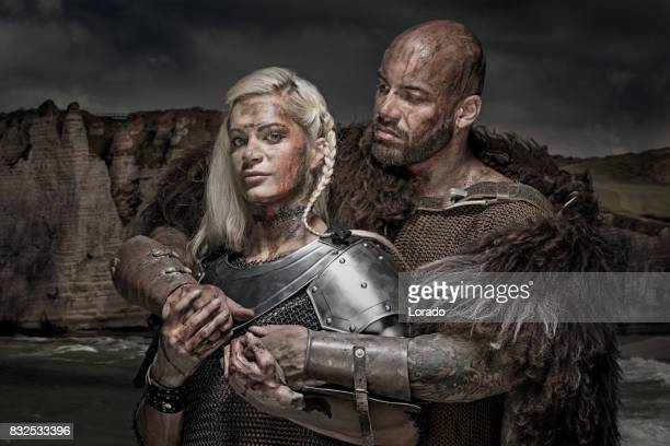 beautiful weapon wielding viking warrior couple in emotional pose - blood love stock photos and pictures