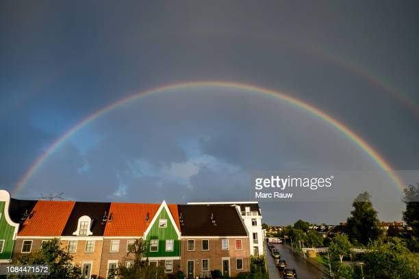 beautiful weather phenomenon: a colorful double rainbow over landsmeer, the netherlands. - light natural phenomenon stock pictures, royalty-free photos & images