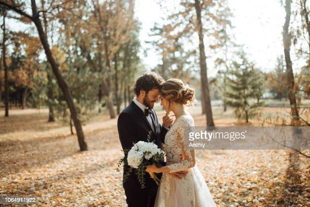 beautiful wedding couple in park. - matrimonio foto e immagini stock