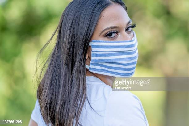 beautiful west indian female wearing a protective mask - west indian culture stock pictures, royalty-free photos & images