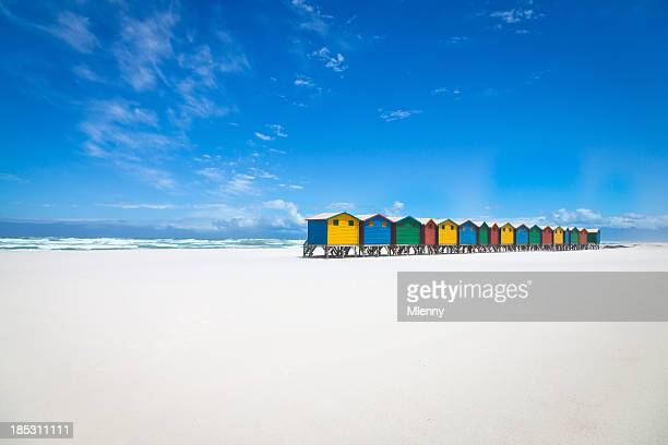 beautiful white sandy beach with colorful huts - south african culture stock photos and pictures