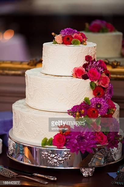 Beautiful White Wedding Cake Centerpiece and Elaborate Floral Arrangement