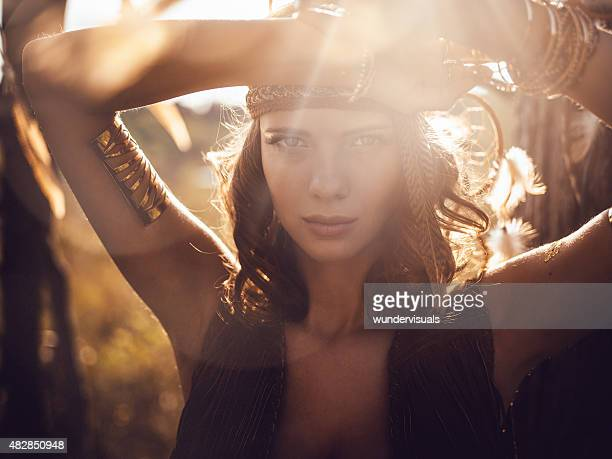 Beautiful wild girl portrait in golden sun flare
