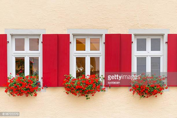 beautiful windows with flowers from bavaria - syolacan stock-fotos und bilder