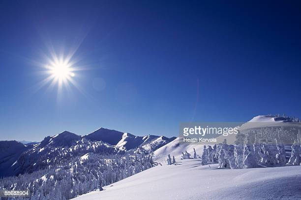 Beautiful winter mountain scene under bright sun.