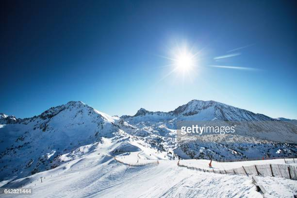 beautiful winter mountains on a bright sunny day - andorra stock pictures, royalty-free photos & images