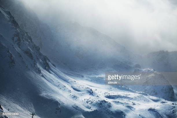 beautiful winter mountains on stormy weather - winter weather stock photos and pictures