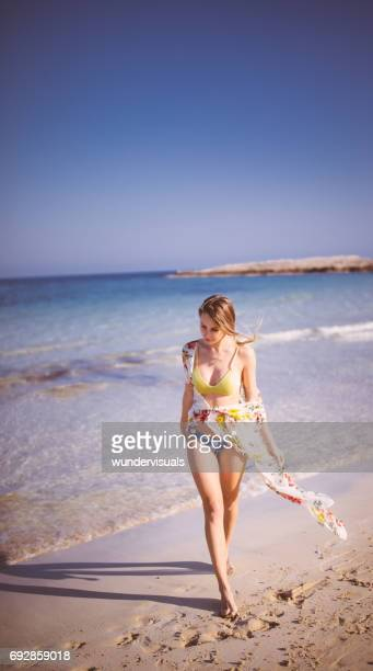 beautiful womam in swimwear walking at the beach in summer - japanese swimsuit models stock photos and pictures