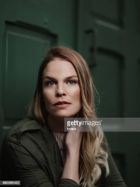Beautiful woman agains green door