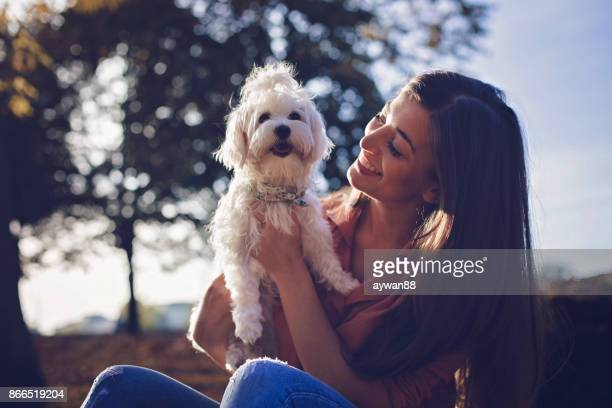 Beautiful woman and adorable dog