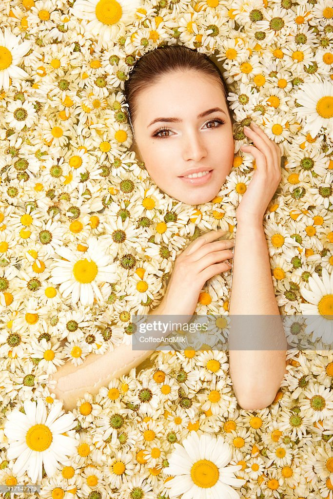 Beautiful woman and chamomiles : Stock Photo