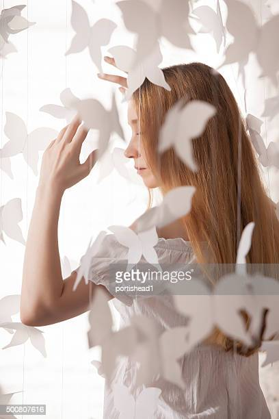Beautiful woman and paper butterflies
