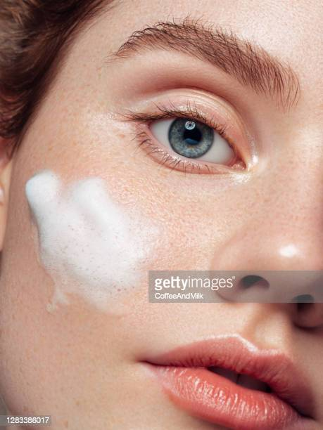 beautiful woman applying cleaning foam on the skin - extreme close up stock pictures, royalty-free photos & images
