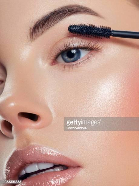 beautiful woman applying mascara - mascara stock pictures, royalty-free photos & images