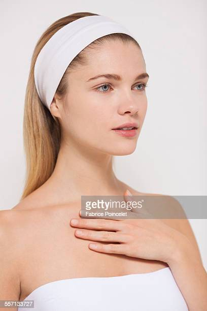 Beautiful woman applying moisturizer