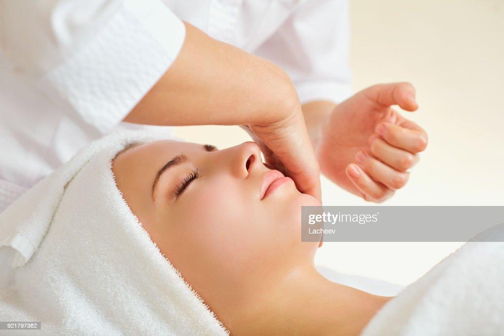 Beautiful woman at a facial massage at a spa salon : Stock Photo