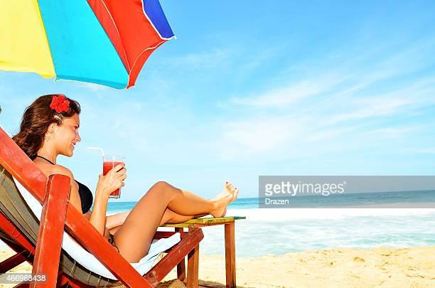 Beautiful woman at  beach in summer near ocean coastline