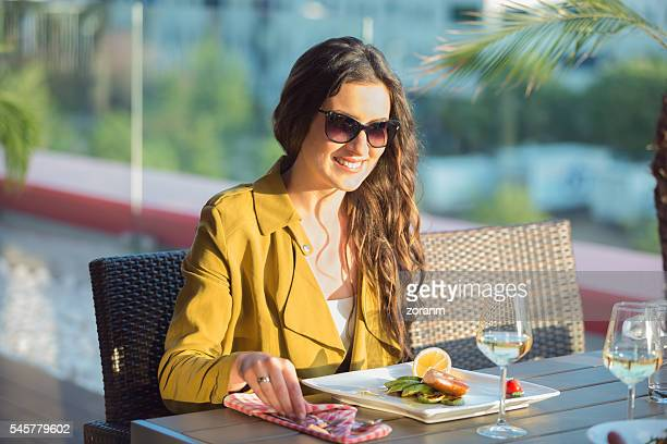 beautiful woman at outdoor restaurant - ready to eat stock pictures, royalty-free photos & images