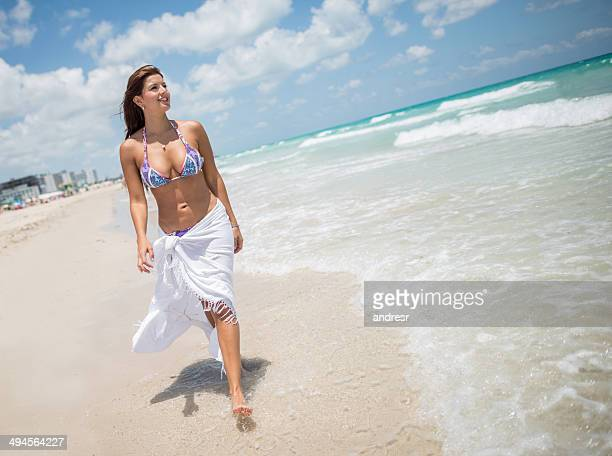 beautiful woman at the beach - sarong stock photos and pictures