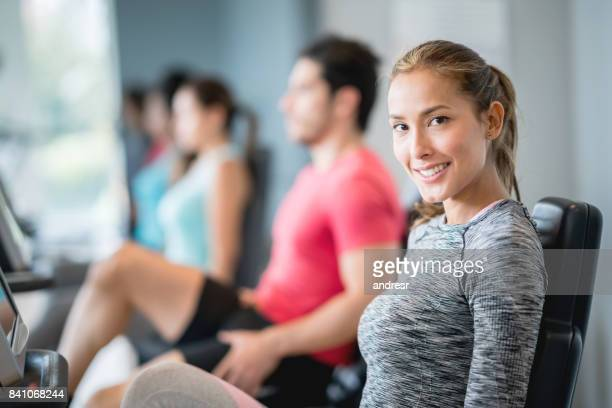 Beautiful woman at the gym exercising on a machine