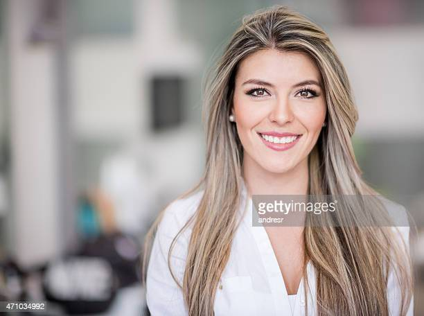 beautiful woman at the hairdresser - beauty care occupation stock photos and pictures