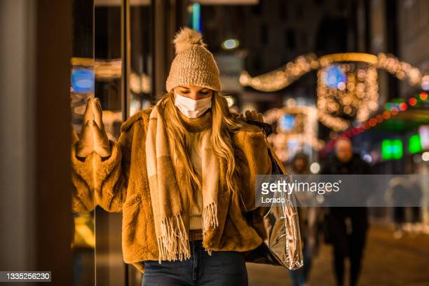 beautiful woman at winter shopping during the corona virus pandemic - north holland stock pictures, royalty-free photos & images