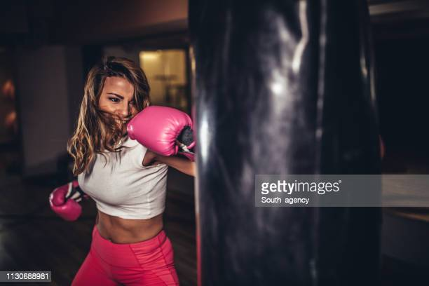 beautiful woman boxer training - femininity stock pictures, royalty-free photos & images