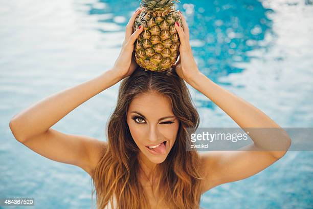 Beautiful woman by swimming pool.