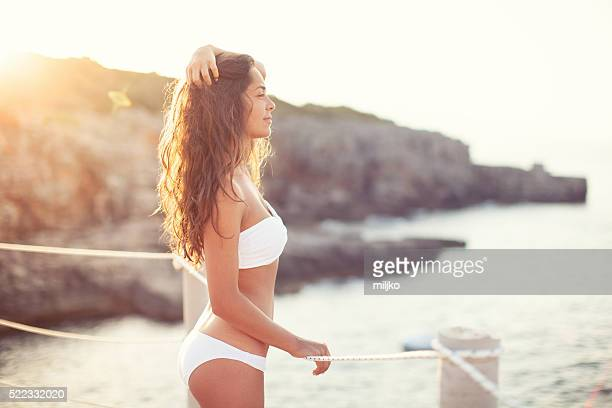 beautiful woman by the sea - swimwear stock photos and pictures