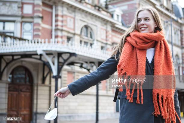 a beautiful woman celebrating the end of the virus outbreak - lockdown stock pictures, royalty-free photos & images