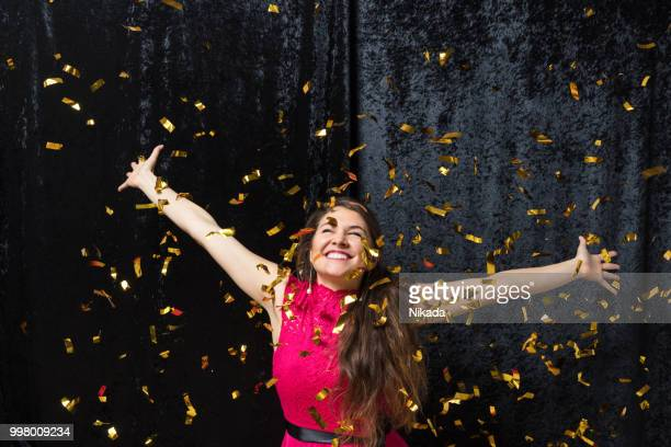 beautiful woman celebrating with glitter - evening ball stock pictures, royalty-free photos & images