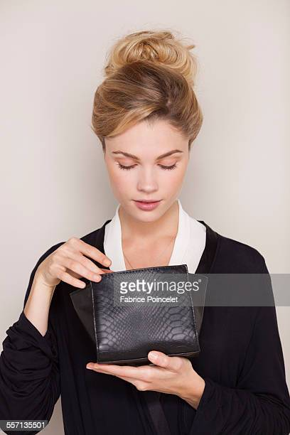Beautiful woman checking her makeup bag