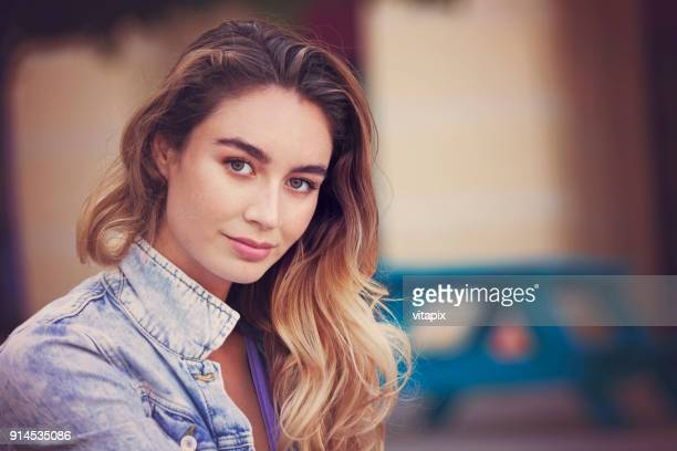 beautiful woman city portrait - wishful skin stock pictures, royalty-free photos & images