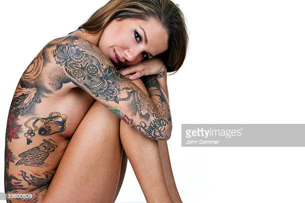 Beautiful woman covered with tattoos