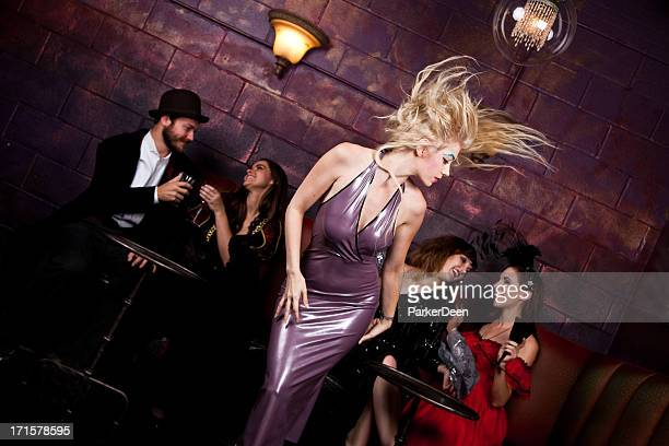 beautiful woman dancing in bar - latex stock photos and pictures