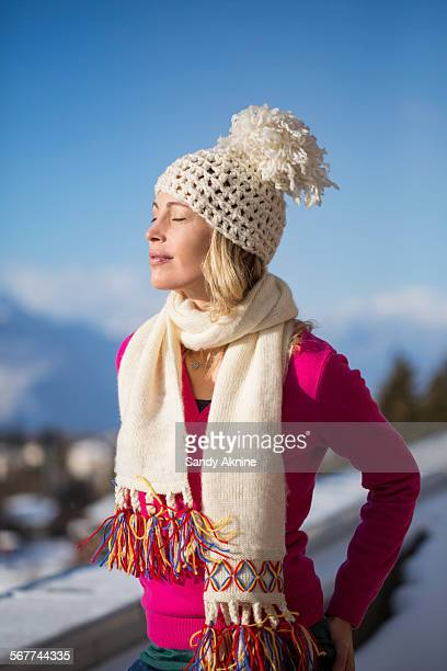 beautiful woman day dreaming, crans-montana, swiss alps, switzerland - einzelne frau über 40 stock-fotos und bilder