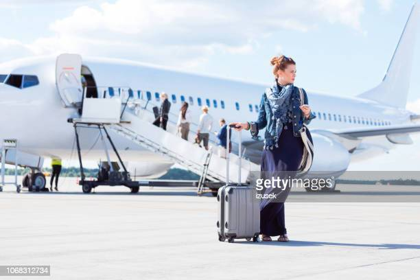 beautiful woman disembarking the flight - getting out stock pictures, royalty-free photos & images