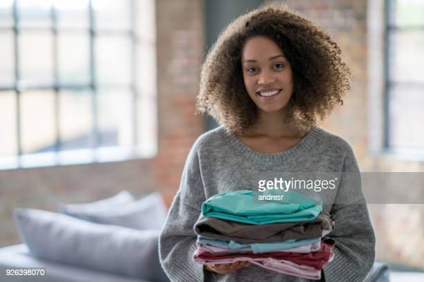 Beautiful woman doing the laundry at home