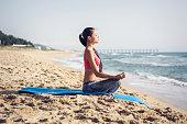 young asian female making yoga exercises