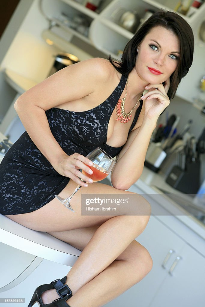 Beautiful woman drinking a glass of rose wine : Foto de stock