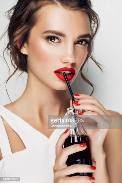 Beautiful woman drinking soda