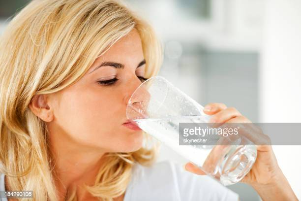 Beautiful woman drinking water