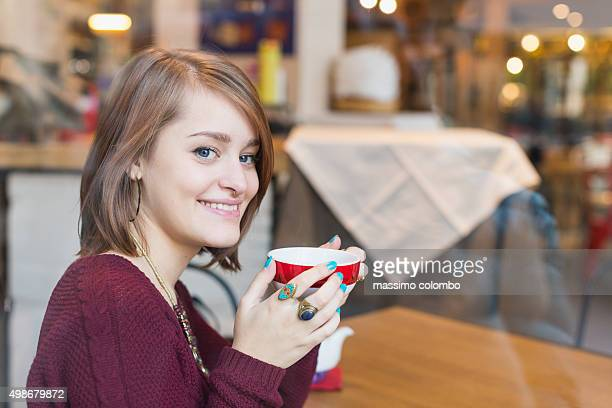 Beautiful woman drinks a cup of tea