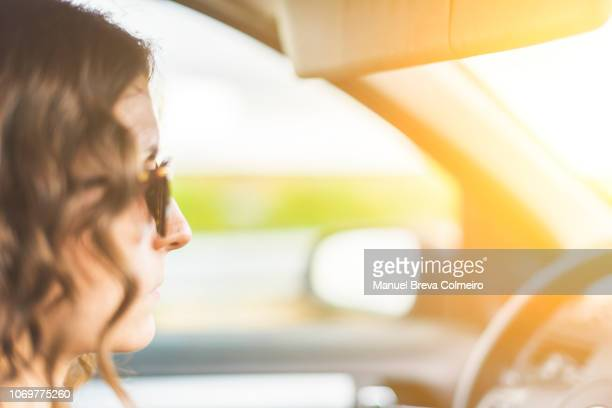 beautiful woman driving her car - green car crash stock pictures, royalty-free photos & images
