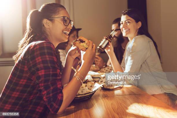 beautiful woman eating a burger