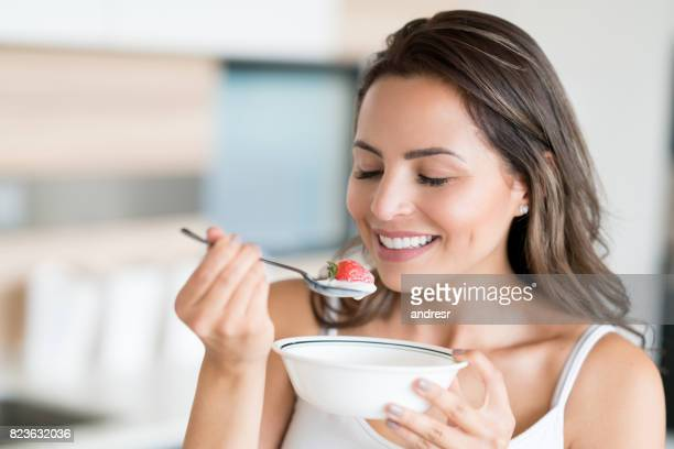 Beautiful woman eating a healthy snack