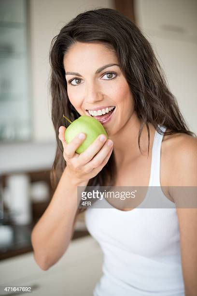 Hot girl eating apple getty images voltagebd Gallery
