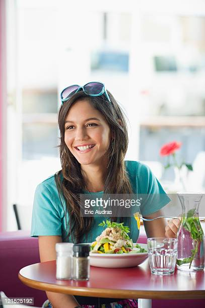 Beautiful woman eating food in a restaurant