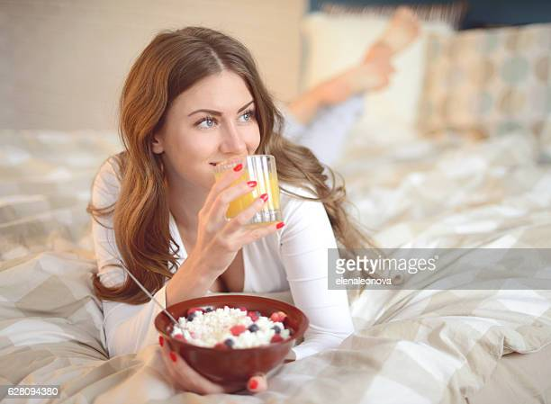beautiful woman eats cottage cheese with berries